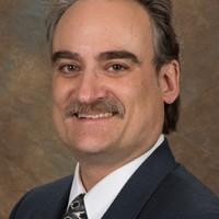 Dr. Nelson Binggeli
